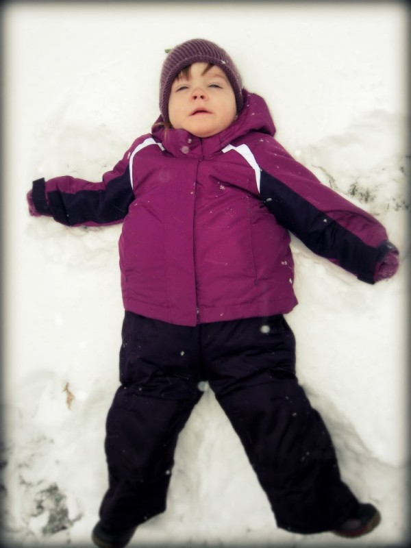we made our first snow angel with a bit of help from mom and she seemed to like it except for the snow falling into her eyes while i snapped a couple - Christmas Story Bundled Up